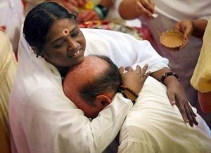 Ammachi has hugged over 25 million people and celebrated her 50th birthday with President Bill Clinton